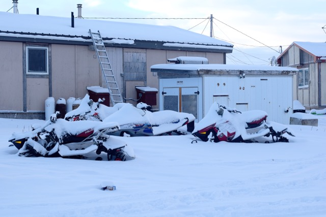 Snow Machines Covered in Snow in Brevig Mission, Alaska
