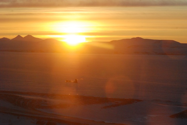 View of a dog musher from the parsonage in Brevig Mission, Alaska